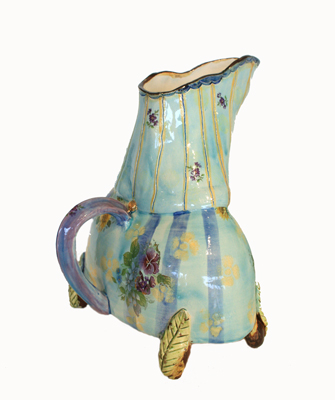GREEN/BLUE WIDE PITCHER W/ PURPLE HANDLE & LEAF LEGS, MARIA COUNTS
