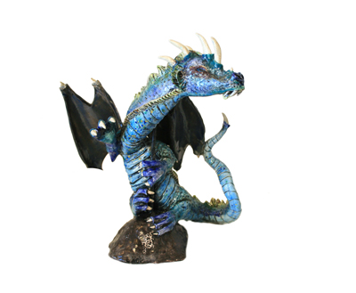 BLUE & GREEN DRAGON WITH HORNS HOLDING POLE ON ROCK, MARIA COUNTS